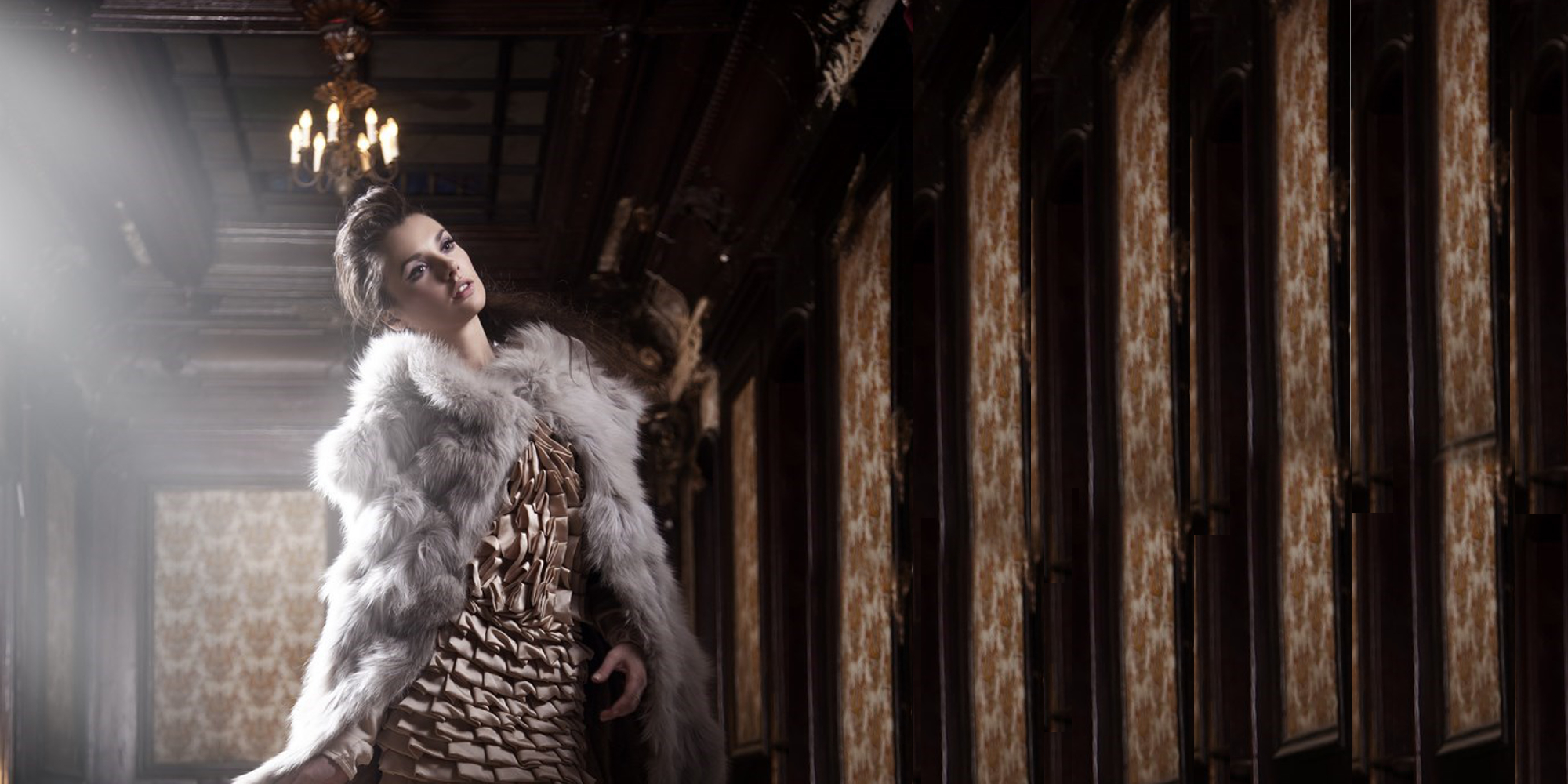 Woman with fur coat, high fashion dress, representing the Haute Couture collection of rings